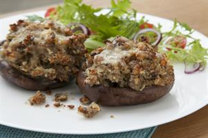 Flat Mushrooms stuffed with Sausage Meat and Garlic Butter